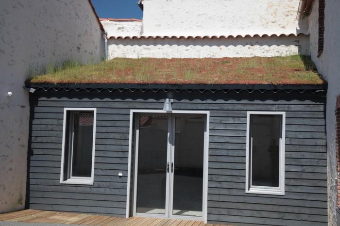 Gite avec un toit végétalisé